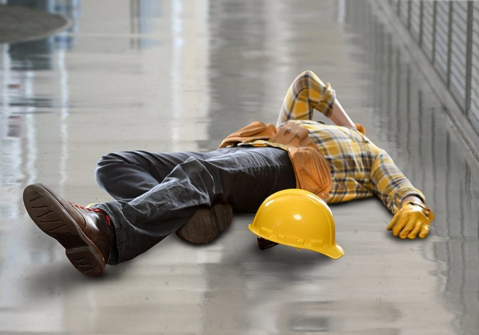 Injured construction worker laying on floor after fall